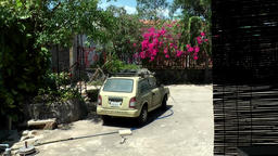 Vietnam Phú Mỹ district villages 077 car in a dusty inner courtyard Footage