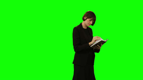 Beautiful businesswoman writing in diary Footage