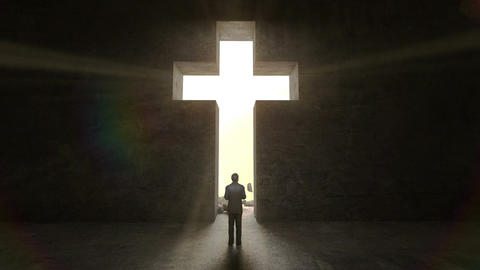Man standing in front of holy cross on the black wall Animación