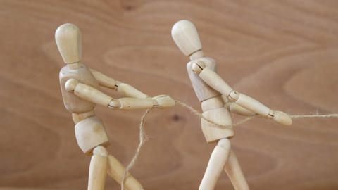 Figurine playing tug-of-war Footage