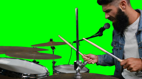 Drummer singing while playing drum Live Action