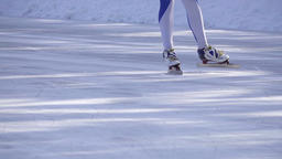 Speed ice skater skating race HD video slow-motion. Skates boots slides on legs  Footage