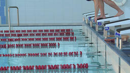 Male swimmer jumps off starting block start swims pool HD slow-motion video Footage