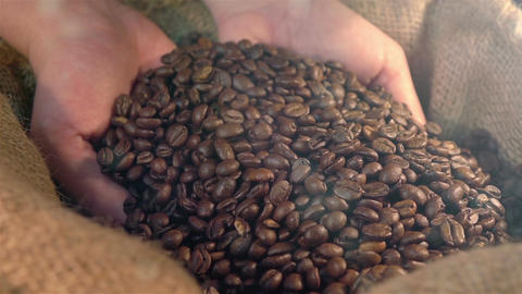 Two videos of showing coffee beans in real slow motion Footage