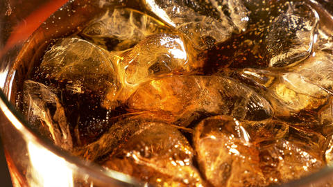Three videos of cold cola with bubbles in 4K Footage
