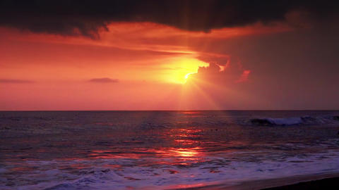 Spectacular sunset seascape with last beams of setting sun. Evening tropics Footage