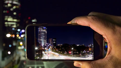 Shoot the night city with a smartphone Footage