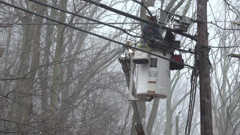 Line worker inspects cables on a misty morning Footage