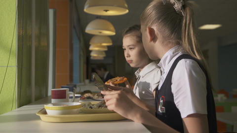 Schoolgirls Eat Dinner and Talk at School Canteen Footage