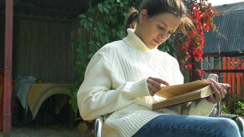 Sensual young girl reading book. Autumn time Footage