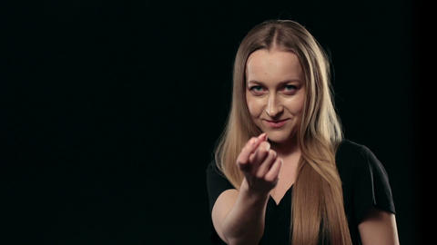 Happy charming woman gesturing beckoning isolated Footage