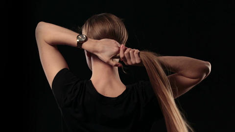Woman holding long hair and pulling blond hair Footage