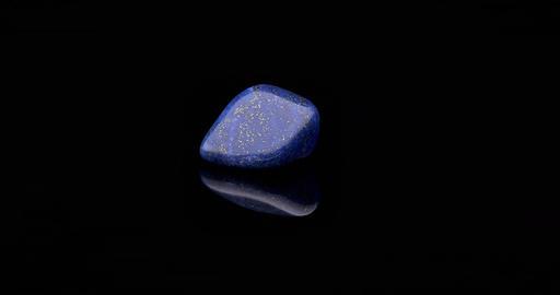 Lapis Lazuli gemstone rotating black surface Footage