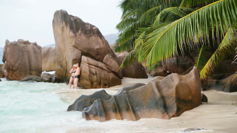Tourists at Anse Patates, La Digue, Seychelles, editorial