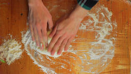 Rolling dough with rolling pin. Chef hands rolling dough ball with dough roller Live Action
