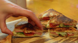 Woman preparing a tasty sandwiches. Small square sandwich ビデオ