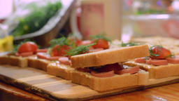 Woman preparing a tasty sandwiches. Small square sandwich Footage
