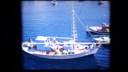 1972 - Greece trip tourists are looking at the shore from the bridge then climb  Footage