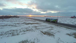 Aerial view of truck moving on winter road. Amazing sunset. Nature landscape Footage