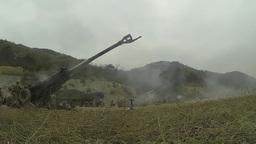 Artillery gun line firing for effect at SSang Yong 2014 Footage