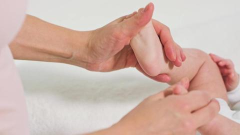 Mother Massaging Little Baby's Feet Footage