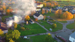 Burning house. Autumn city landscape. Smoke and fire. Aerial footage ビデオ