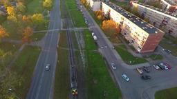 Train rolls through scenic rural city at sunset. Aerial footage Footage