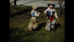 USA 1940s - 1950s: Children Playing Cowboy With Toy Guns - Vintage Americana Footage