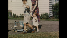 USA 1940s - 1950s: Mother with Toddler and Young Child Clip 1 - Vintage American Footage