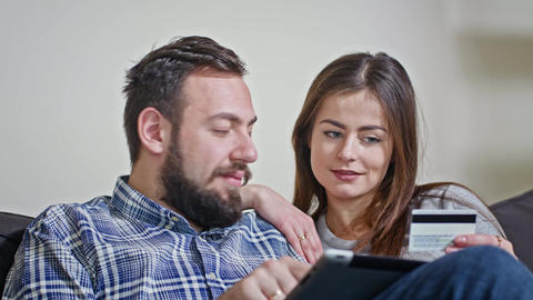 Young Couple at Home Buying on Internet Footage