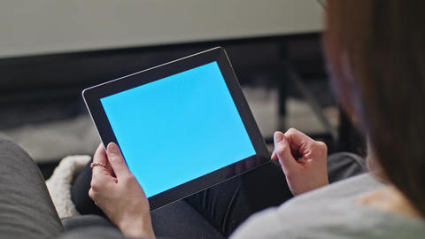 Girl Using Digital Tablet PC with Blue Screen Footage