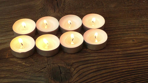 Candles on a wood background Footage
