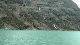 Greenland Prince Christian Sound 010 steep coast with waterfall Footage