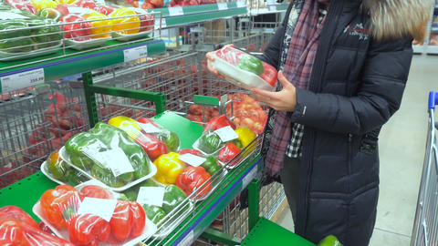 Woman in supermarket chooses pepper Footage