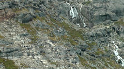 Greenland Prince Christian Sound 011 waterfall with meltwater on a rock face Footage