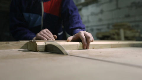 Carpenter cutting wooden plank with table saw Footage