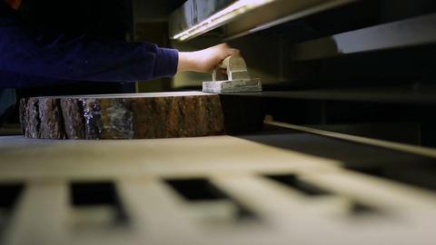 Worker operating wood sanding machine in carpentry Footage