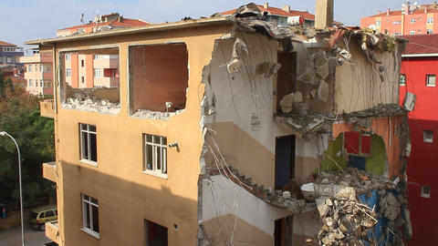 Destruction of concrete floors of old house with excavators. Tower block under d Footage