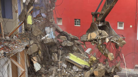 Hydraulic machinery working to get rid of the rubbish in a demolition site Footage