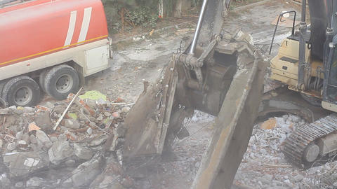 Heavy duty machinery running to get rid of the rubbish in a demolition site Footage