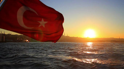 Turkish flag waving on the stern of an Istanbul ship at sunset Image