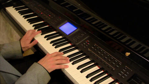 Close up of a man's hands playing a piano. Making music Footage
