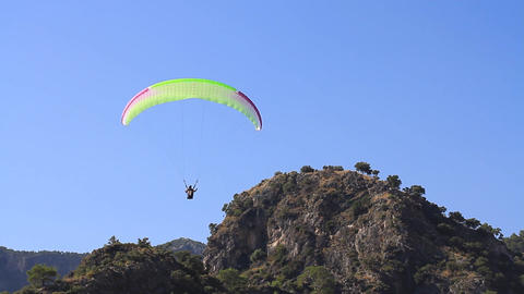 Paraglider pulling brakes of large tandem wing simultaneously for the landing Footage