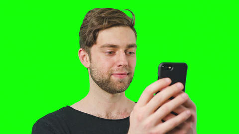 Man Reads Messages on Phone Screen Live Action