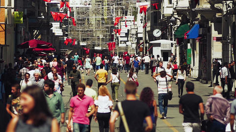 Pedestrians walk slow motion on Istiklal Caddesi, city's iconic pedestrian-onl Footage