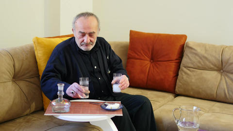 Old man drinks Raki and eats White Cheese Footage