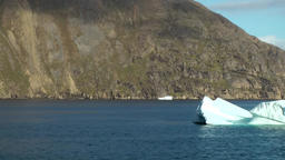 Greenland Prince Christian Sound 060 an icebergs swims Footage