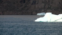 Greenland Prince Christian Sound 061 white iceberg swims in blue ice water Footage