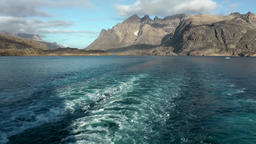 Greenland Prince Christian Sound 066 stern wave and mountain scenery Footage