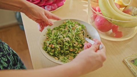 Woman Hands Mixing Salad with Spoon Footage